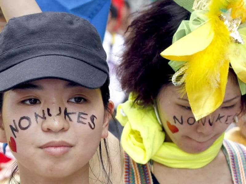 Protesters bearing anti-nuclear face-painting take part in an anti-nuclear march in Hiroshima.