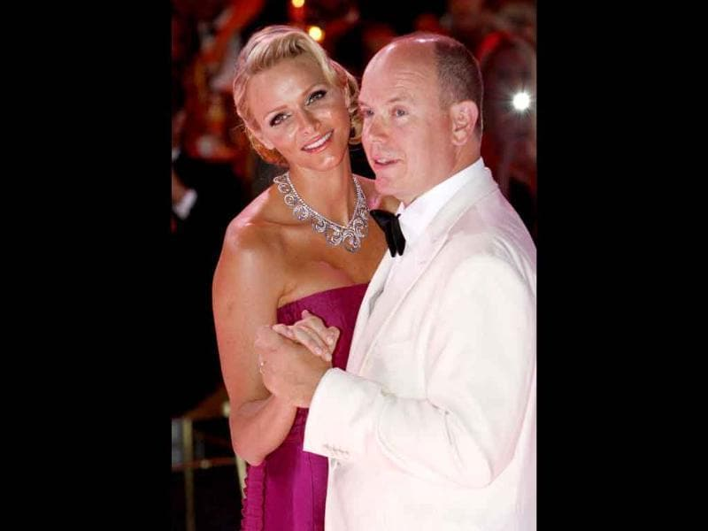 Prince Albert II of Monaco (R) and Princess Charlene (L) dance during the 63th annual Red Cross Gala in Monaco. Created in 1948, the gala is an annual fundraiser held in Monaco by its Princely Family during the summer.