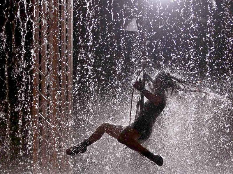 An artist performs during the Waterwall show in Lisbon.