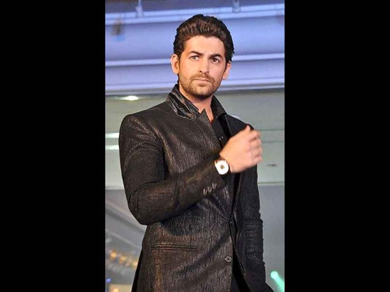 Neil Nitin Mukesh walks the ramp during the 'Ticket to Bollywood' section of the second Indian International Jewellery show in Mumbai. (AFP)