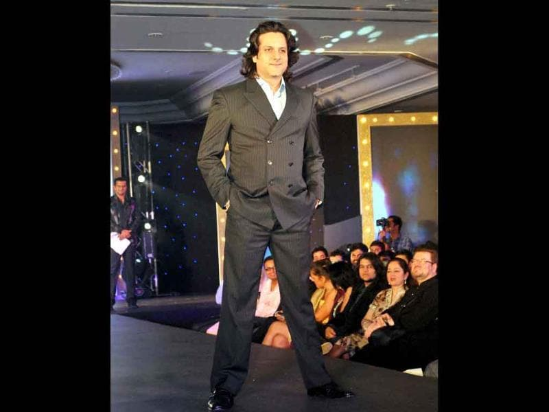 Fardeen Khan walks the ramp during the Gitanjali fashion show 'Ticket to Bollywood' in Mumbai on Friday night.