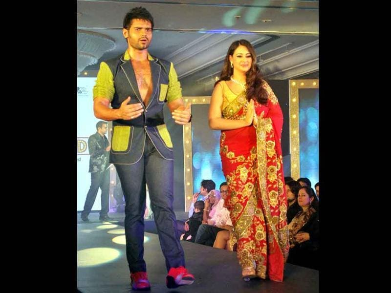 Mithun Chakraborty's son Mimoh with wife walks the ramp during the Gitanjali fashion show 'Ticket to Bollywood' in Mumbai on Friday night.