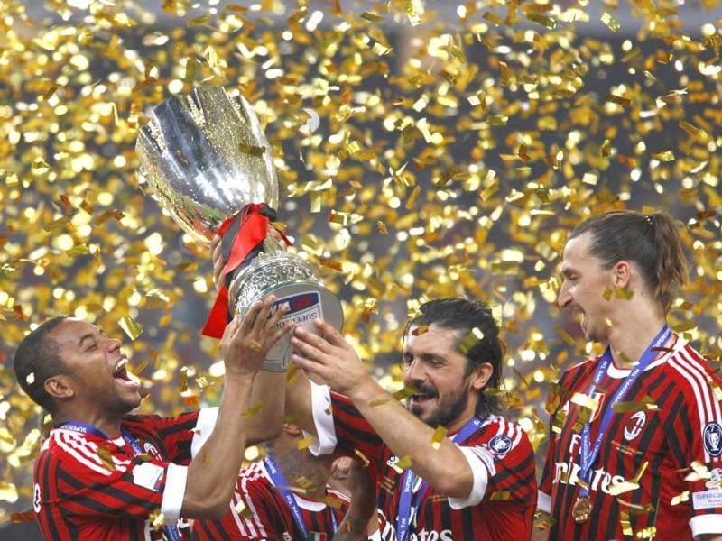 AC Milan's Robinho (L), Gennaro Ivan Gattuso (C) and Zlatan Ibrahimovic celebrate with the trophy after winning the Italian Super Cup soccer match against Inter Milan at the National Olympic Stadium in Beijing.