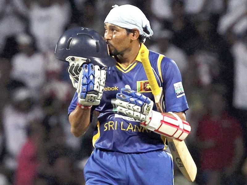 Sri Lanka's captain Tillakaratne Dilshan kisses his helmet after scoring his century during their first Twenty20 cricket match against Australia in Kandy.