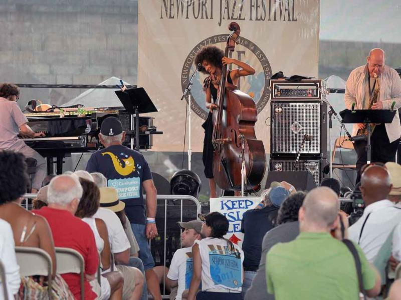 Esperanza Spalding on bass performs with Friends (Leo Genovese on piano and Bob Mover on tenor) at the Quad stage.