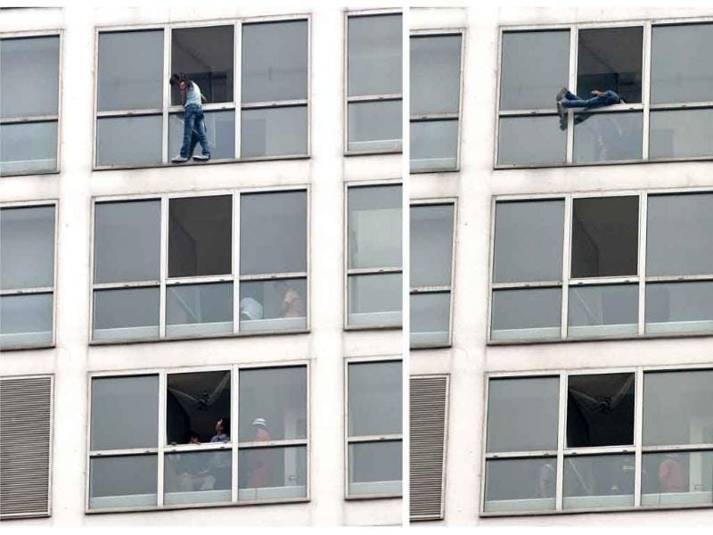 This combo photo show a Chinese woman who attempted to commit suicide, left, as she is pulled back by a rescuer, right, at a high-rise residential and office complex in Beijing.
