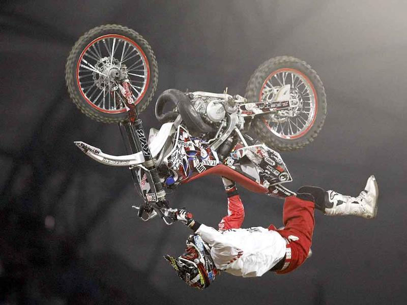 Japan's Eigo Sato performs during the Red Bull X-Fighters 2011 World Tour freestyle motorcross event in Poznan, western Poland.