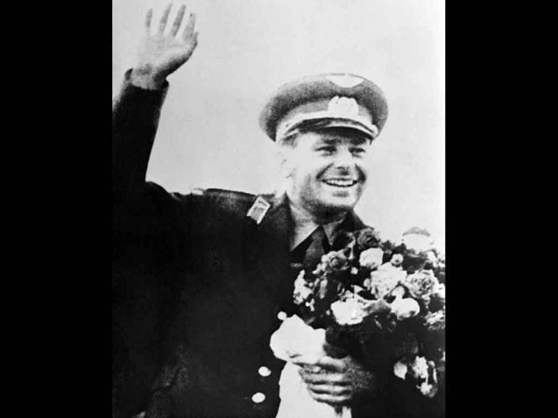 Soviet cosmonaut Gherman Titov waves after being greeted at Moscow airport after the Vostok 2 space mission, on August 9, 1961.
