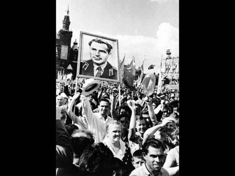 Muscovites welcome Soviet cosmonaut Gherman Titov after he arrived from the Vostok 2 space mission, on Red Square in Moscow, on August 9, 1961.