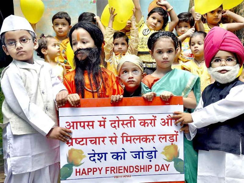 Schoolchildren dressed up as Manmohan Singh, Sonia Gandhi, Ramdev and Anna Hazare during Friendship Day celebrations at a school in Bhopal.