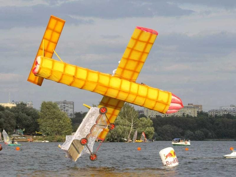 A makeshift aircraft plummets into the Moskva River during the Red Bull Flugtag Moscow 2011 competition in Russia.