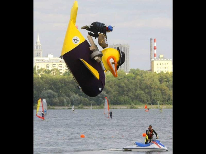 A competitor jumps with his makeshift aircraft into the Moskva River during the Red Bull Flugtag Moscow 2011.
