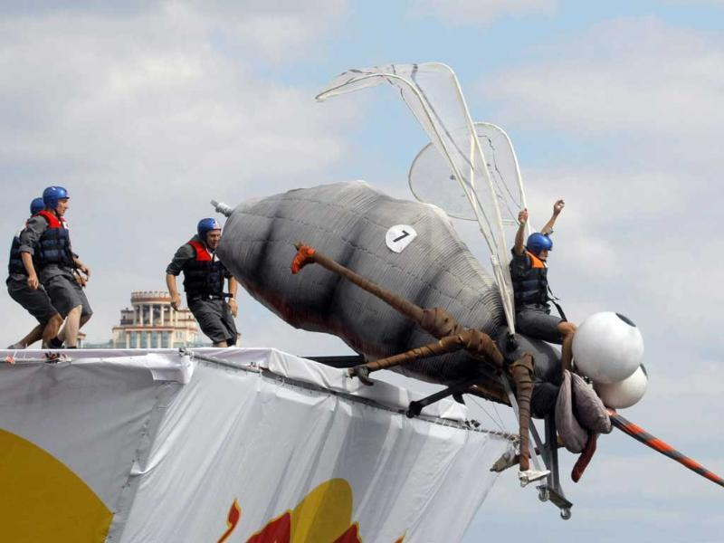 A makeshift aircraft is launched into the Moskva River during the Red Bull Flugtag Moscow 2011 competition.
