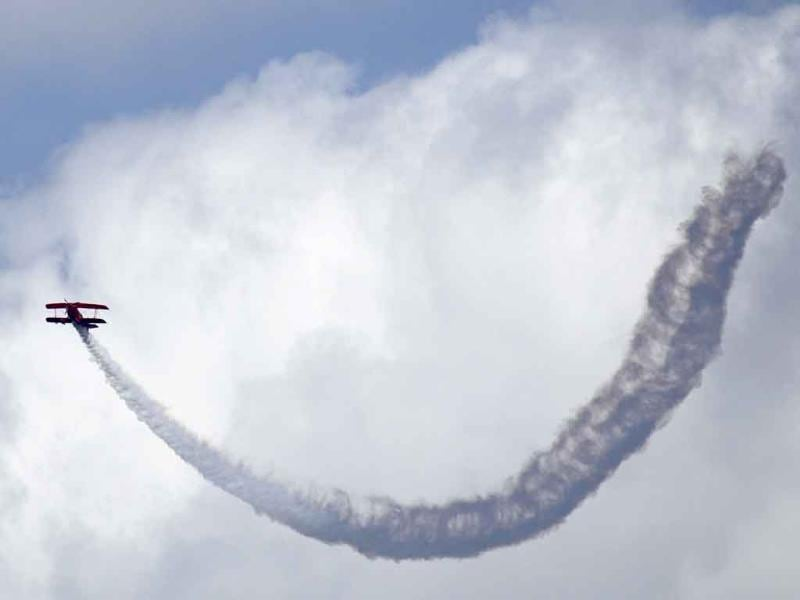 Team Oracle's Sean D Tucker performs in the Seafair Air Show in Seattle.