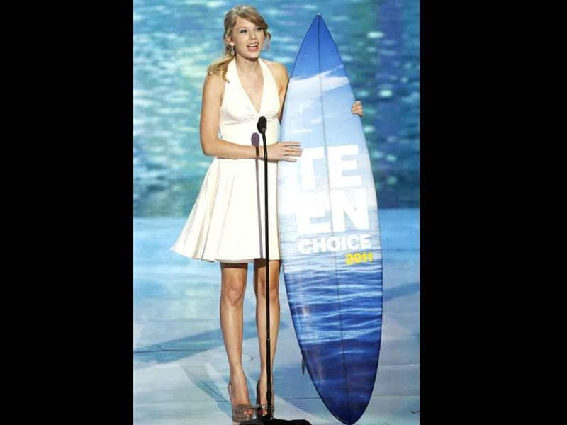 Singer Taylor Swift accepts the Ultimate Choice Award at the Teen Choice Awards at the Gibson amphitheater in Universal City, California