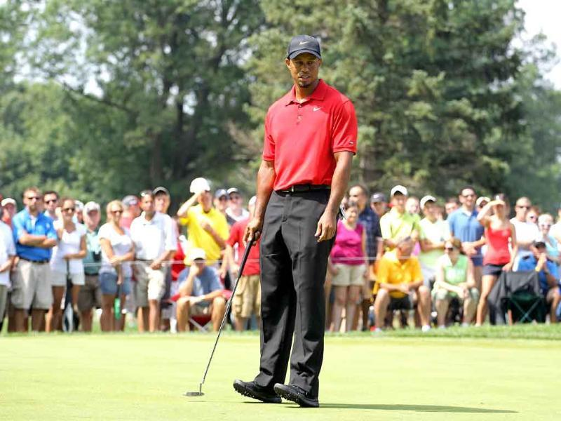 Tiger Woods reacts to a putt during the final round of the World Golf Championships-Bridgestone Invitational on the South Course at Firestone Country Club, Akron, Ohio.