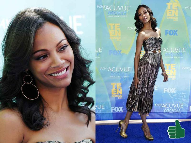 Zoe Saldana looks like a golden goddess. She's wearing big brands too - Lanvin dress, Salvatore Ferragamo clutch and Alexander McQueen shoes.