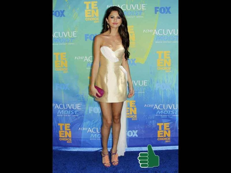 Selena Gomez goes sophiticated glam in an off-shoulder Erin Fetherston dress. Check out her super cool Brian Atwood heels.