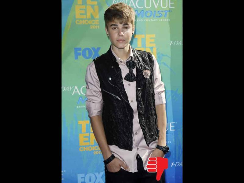 Justin Bieber looks washed out with his crooked bow-tie over a T-shirt over a button down and leather vest.
