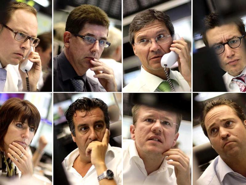A combination of eight pictures show share traders reacting in front of their monitors at Frankfurt's stock exchange.