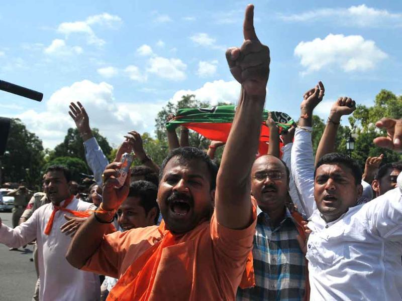 BJP Yuva Morcha activists protest against the UPA government at Vijay Chowk in New Delhi