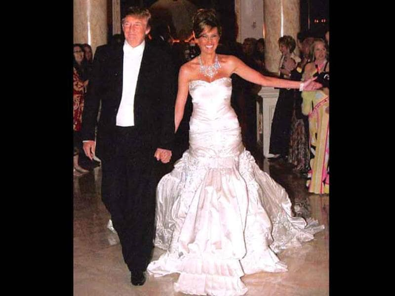 "Donald Trump and Melania Knauss: January 22, 2005For a man known for his extravagance, Donald Trump's wedding was not much of a surprise. His wife Melania's gown was worth $100,000 with a 13-foot train, 1500 crystals and pearls, and weighed 60 pounds. Amongst other things were Billy Joel crooning ""Just the Way You Are,"" a 200-pound cake, 36-piece orchestra and more."