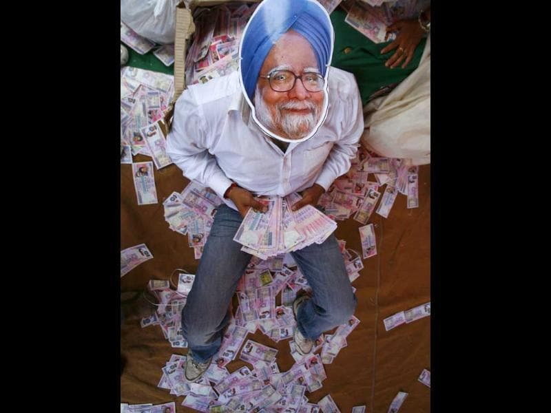 An activist from main opposition Bharatiya Janata Party, wears a mask depicting Prime Minister Manmohan Singh, during an anti-government protest in New Delhi.
