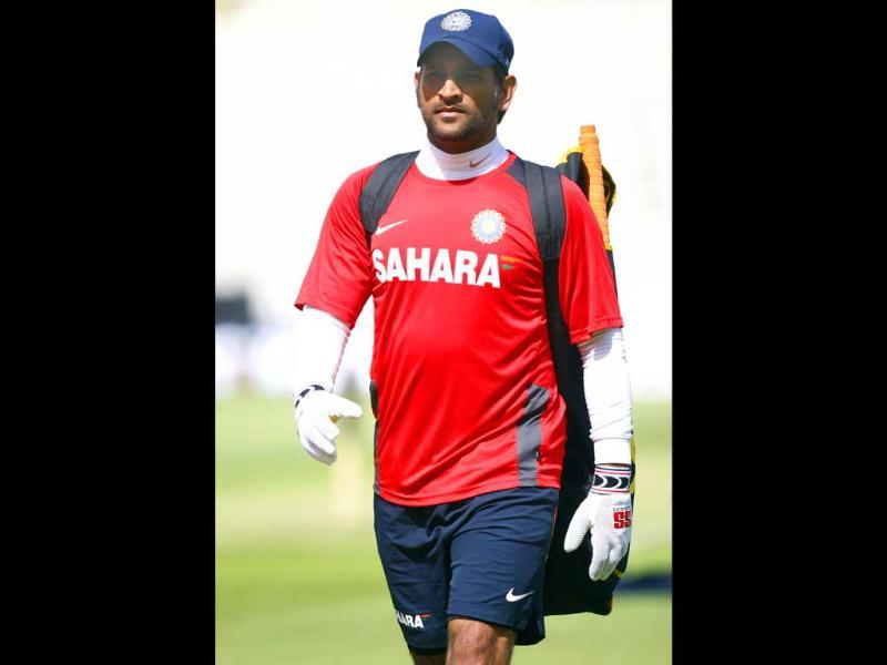Mahendra Singh Dhoni walks to the nets during a practice session at the Edgbaston Cricket Ground, Birmingham, England.