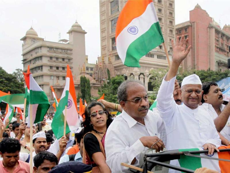 Social activist Anna Hazare along with supporters during a march against government version of lokpal bill introduced in Parliament for discussion, near Dadar railway station in Mumbai.