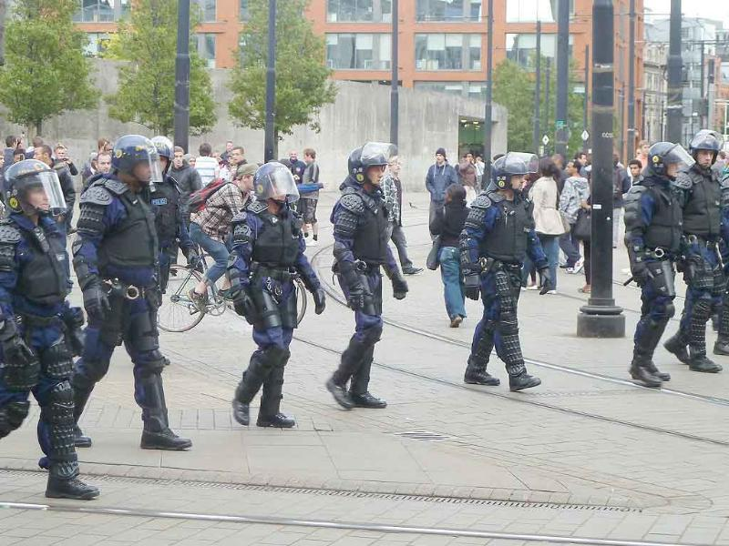 Riot police patrol Manchester city centre after trouble on Market street.