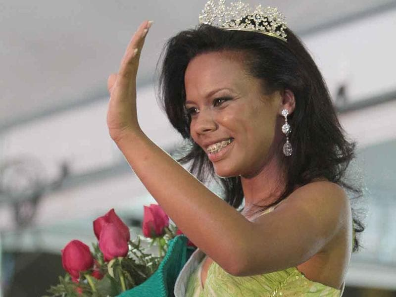 Inmate Raira Paixao waves to the crowd after being elected as Miss Penitentiary 2011 during the beauty contest at the Women's Prison of Brasilia, Brazil.