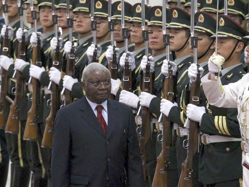 Mozambican President Armando Guebuza inspects the guard of honour during an official welcoming ceremony in the Great Hall of the People in Beijing.