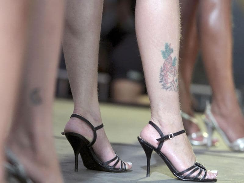 An inmate shows her tattoo while participating in the Miss Penitentiary beauty contest at the Women's Prison of Brasilia.