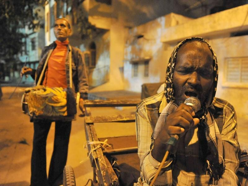 Visually impaired Muslim singer Mohammed Sheik Khaja Bhai (R) and drummer Mohammed Haji Bhai (L) perform as they roam the streets of the old city in Hyderabad during the holy fasting month of Ramadan. For the past 23 years Mohammed shiek Khaja and his group have sang and played music in the streets before dawn to wake up the Muslim residents during the fasting month of Ramadan. Devout Muslims all over the world fast from dawn to dusk during the holy month of Ramadan.