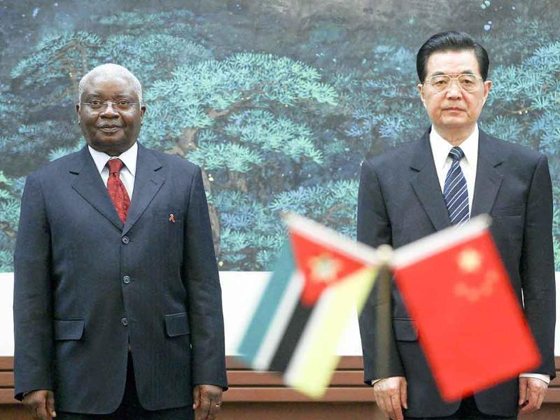 Chinese President Hu Jintao (R) stands next to Mozambique President Armando Guebuza (L) during a meeting at the Great Hall of the People in Beijing. Guebuza is in China for a 6-day official visit at the invitation of the Chinese president.
