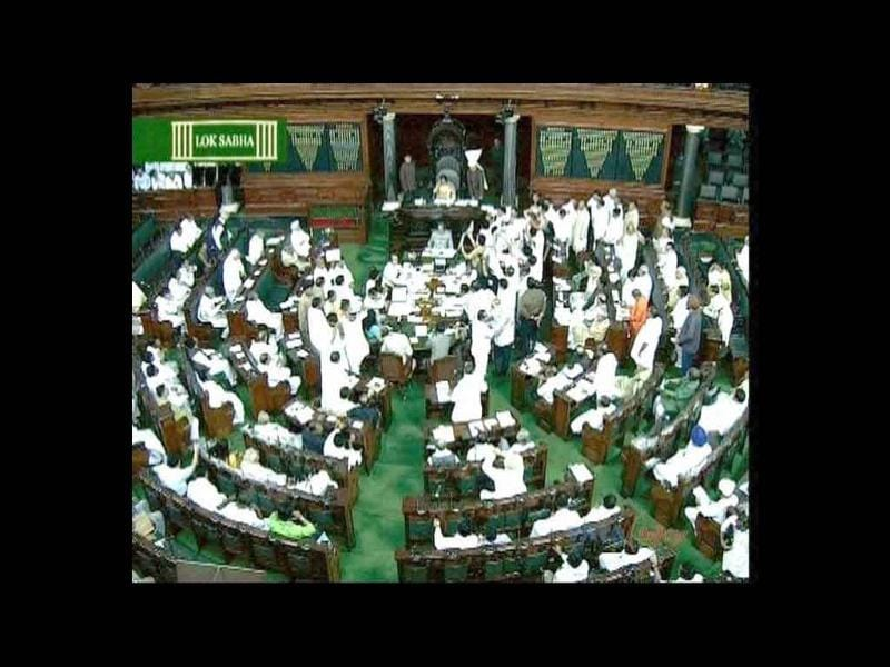 TV GRAB- Members disrupt the proceedings of the Lok Sabha during the Monsoon session in New Delhi.