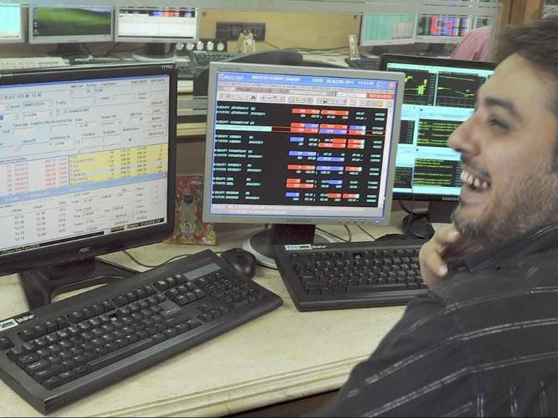 A stock broker smiles during intraday trade in Mumbai. Stocks rebounded, opening nearly two percent higher, in line with Asian markets after the US Federal Reserve's pledge to keep interest rates on hold.