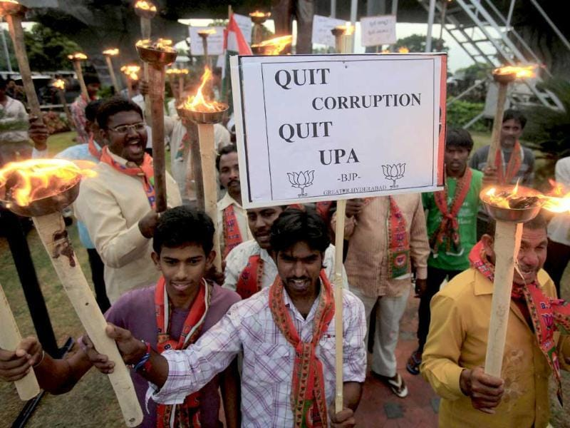 Activists of Bharatiya Janata Party participate in a torch rally during a protest against corruption in Hyderabad.