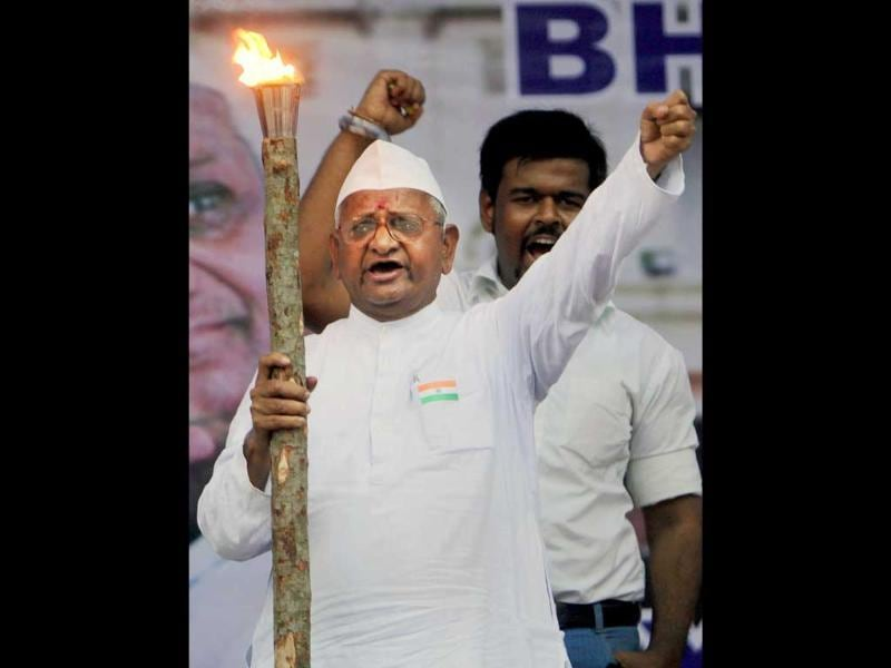 Anna Hazare holds a flame and shouts slogans as he leads a rally against corruption in Mumbai.