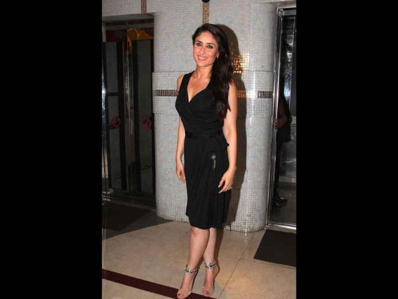 Kareena Kapoor perfectly teams her suede, crystal studded Jimmy Choo nude strappy sandals with a gorgeous black dress.