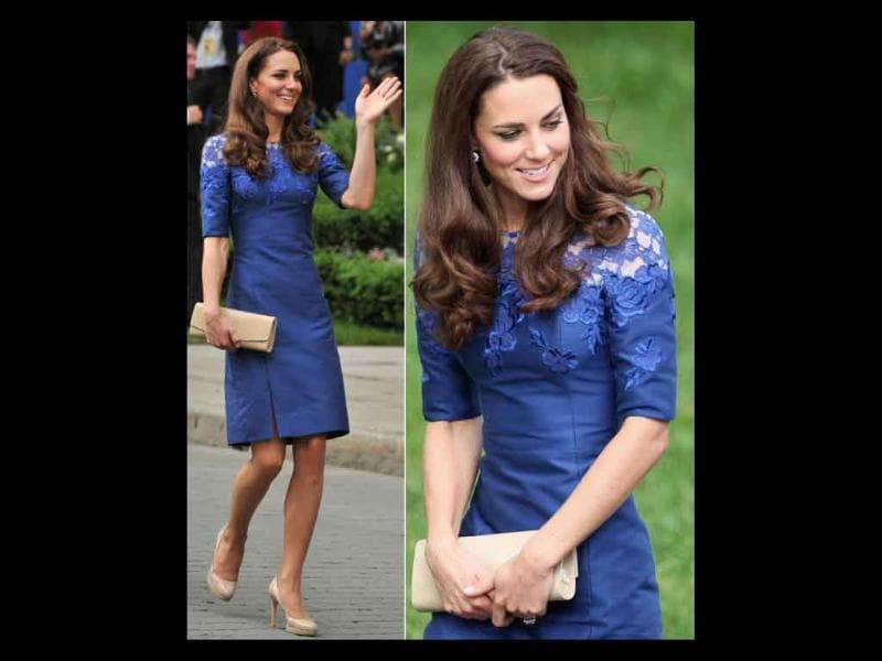 Kate Middleton wears her signature nude platforms and tots her favourite clutch.