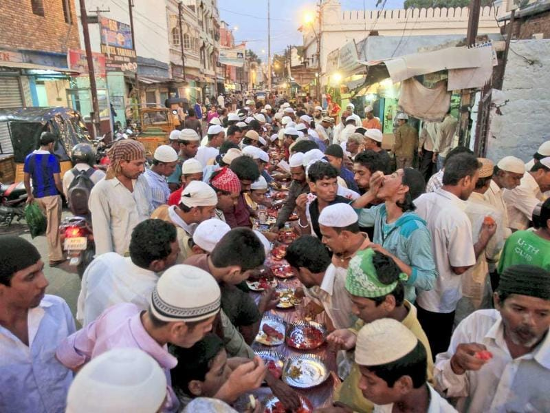 Muslims break their fast on a street during Ramadan in Hyderabad.