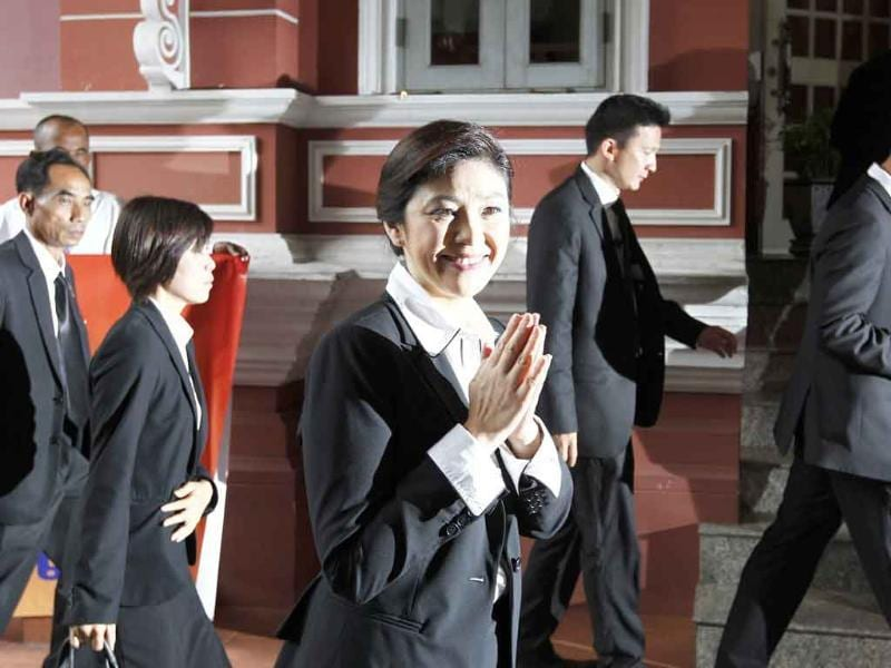 Thailand's first female prime minister Yingluck Shinawatra arrives for the first cabinet meeting at the Government House in Bangkok.