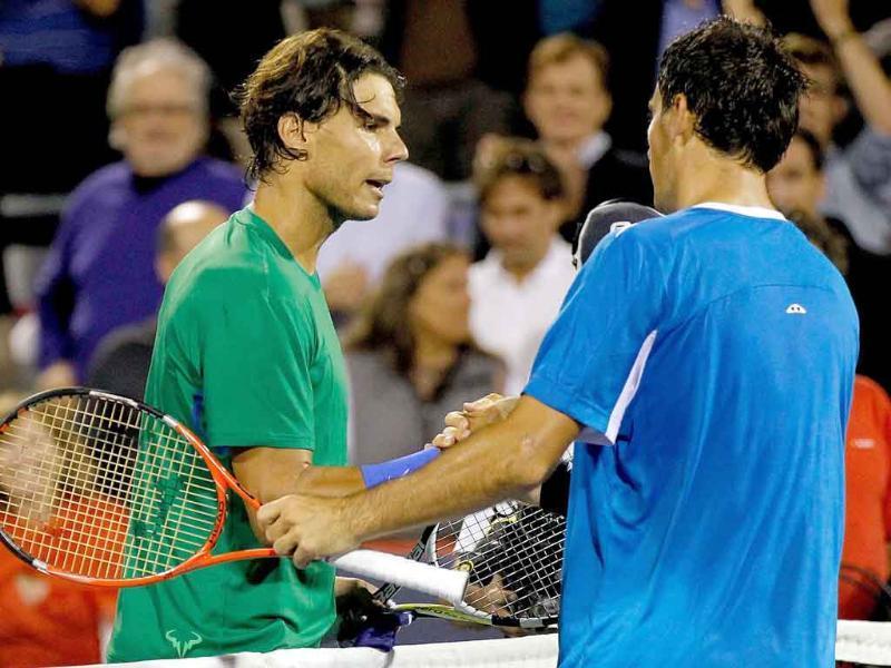 Rafael Nadal of Spain congratulates Ivan Dodig of Croatia after their match during the Rogers Cup at Uniprix Stadium in Montreal, Canada.