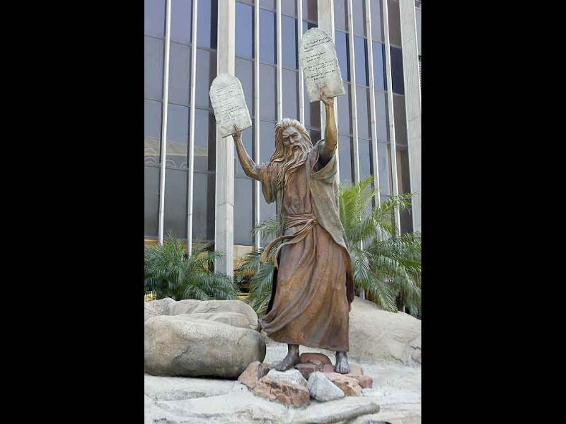 A statue of Moses carrying the tablets on the grounds of the Crystal Cathedral in Garden Grove, California is pictured.