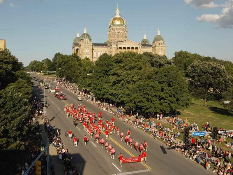 High school marching bands help lead off the Iowa State Fair Parade in front of the state capitol building in Des Moines, Iowa.