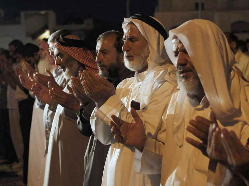 Supporters of the Jordanian opposition and Syrians living in Jordan perform prayers during the holy month of Ramadan before protesting in front of the Syrian Embassy in Amman.