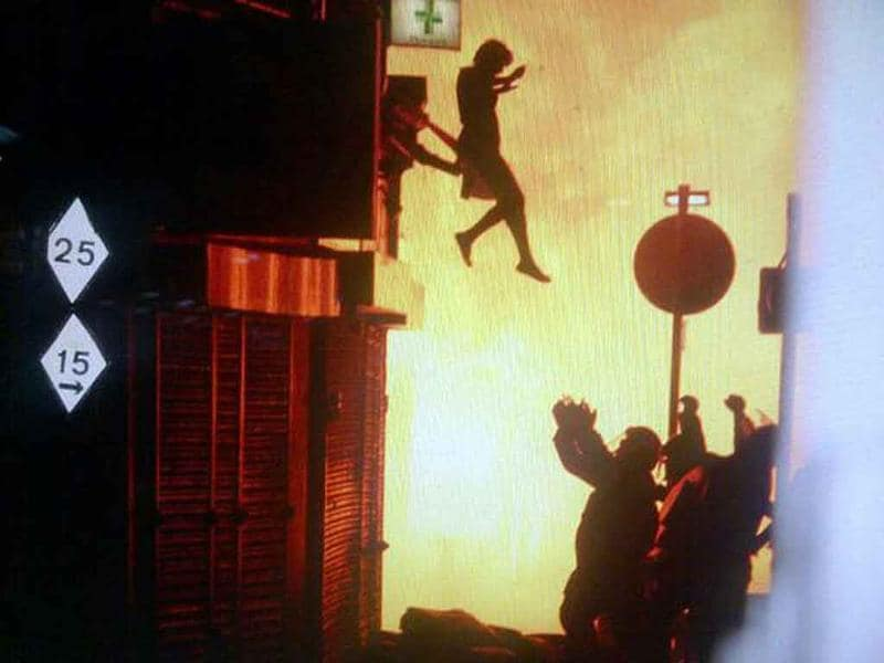 A woman jumps from a burning building in Surrey Street in London in this image taken from Twitter. There was no information available on the outcome of the woman, after this jump.