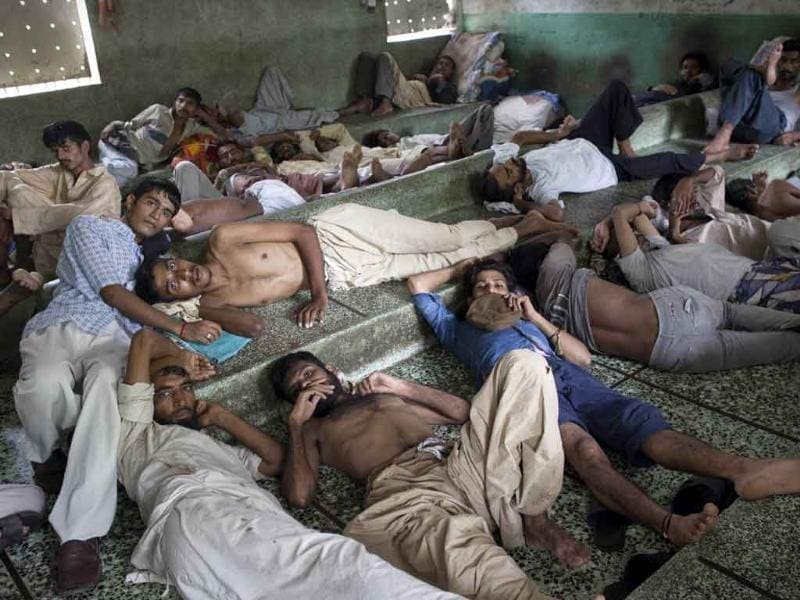 A Pakistani heroin addicts rest at the Edhi rehabilitation centre in Karachi. The rehabilitation centre provides food, shelter and medical treatment for drug addicts.