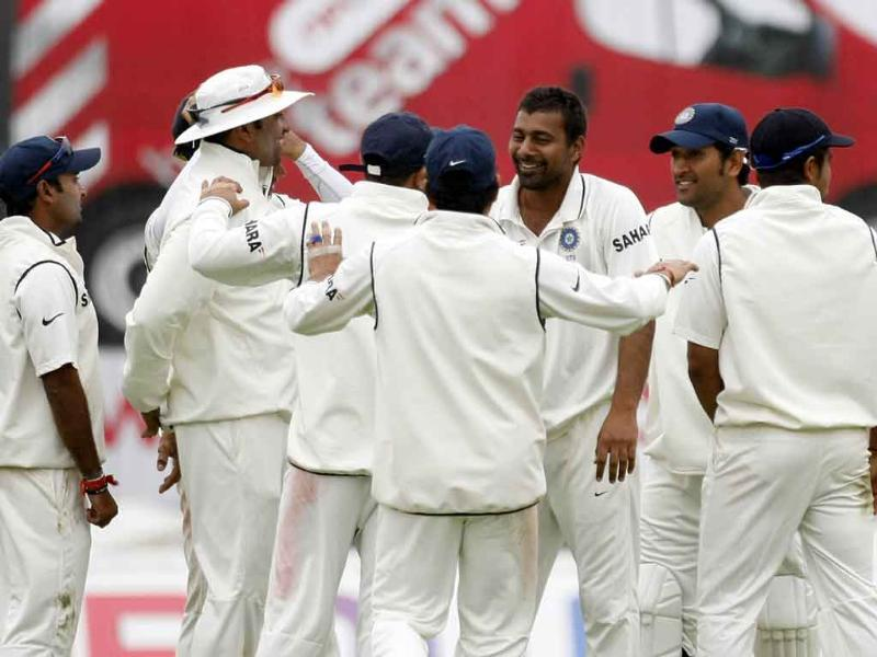 India's Praveen Kumar, third right, is congratulated by teammates after taking the wicket of England's Ian Bell, not pictured, on the second day of the third Test match at the Edgbaston Cricket Ground, Birmingham, England.